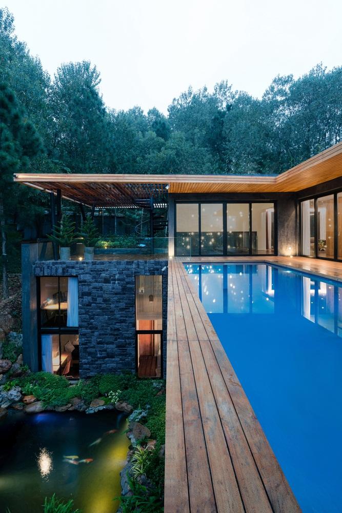 Teak-House-–-A-modern-wooden-house-design-interplay-between-culture-and-environment-25